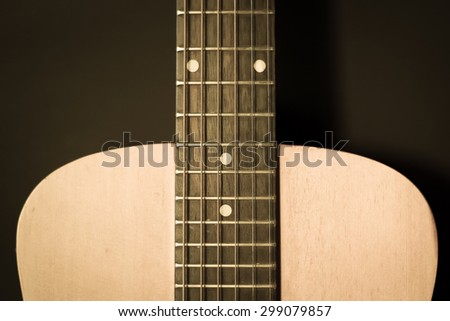 Closeup front view of wooden acoustic guitar