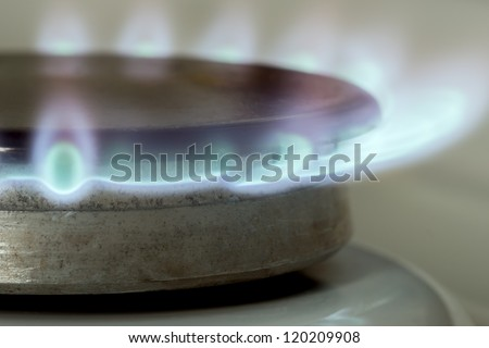 Closeup gas flames from a burner - stock photo