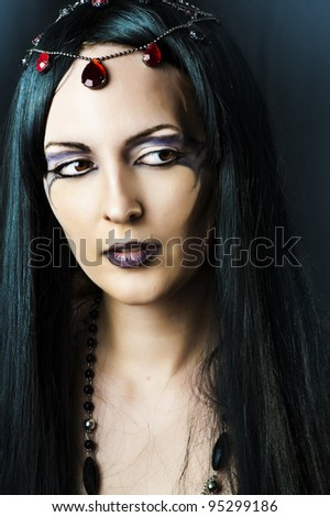 Closeup glamor portrait of young beautiful woman with long black hair