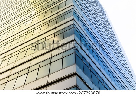 Closeup glass of Modern business building skyscrapers, Business concept of architecture - stock photo