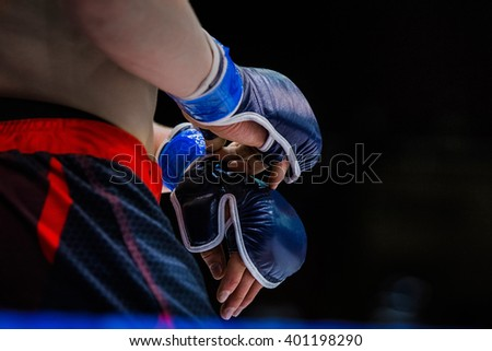 closeup gloves boxer. standing in corner of ring before fight - stock photo