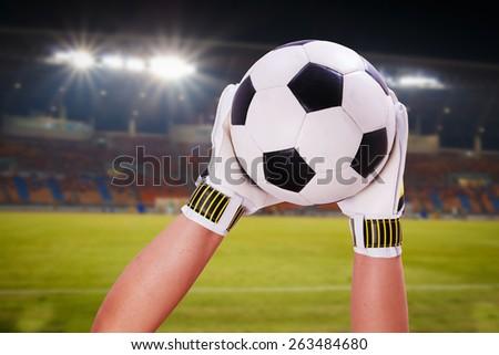 closeup goalkeeper super save on stadium - stock photo