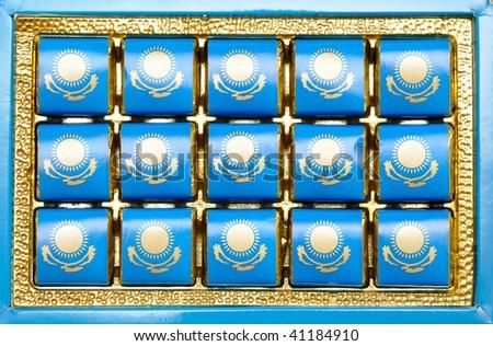 closeup gold foil chocolate candies - stock photo