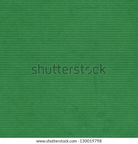 Closeup green cardboard texture, background. Lined relief paper. Seamless pattern - stock photo
