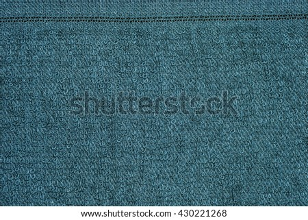 Closeup green towel texture fabric for background and design with copy space for text or image. - stock photo