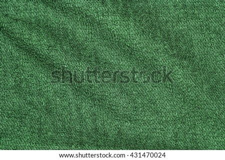Closeup green towel texture fabric for background and design with copy space for text or image. Dark edged. - stock photo
