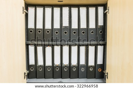 Closeup group of document file in file cabinet background - stock photo