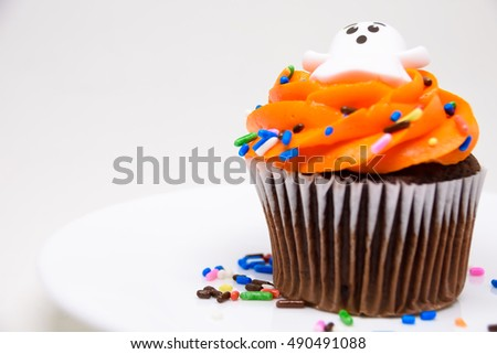 Closeup Halloween Cup Cake isolated on white background / Selective focus