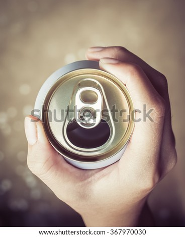 closeup hand holding and opening can - stock photo