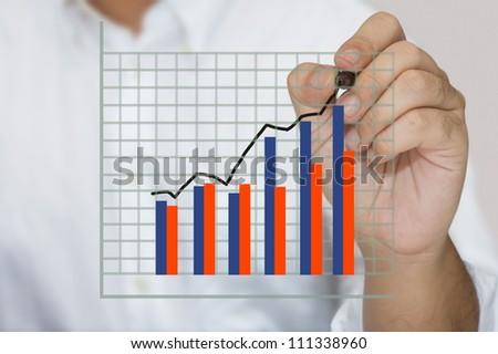 Closeup hand writing success graph - stock photo