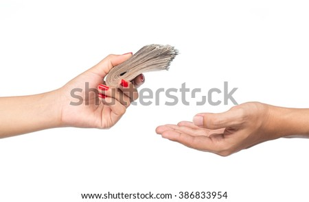 Closeup hands giving money isolated on white background - stock photo