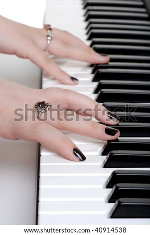 closeup hands playing a piano