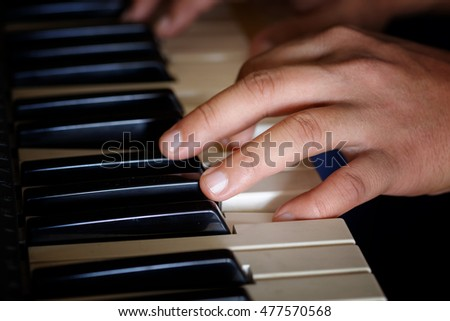 Closeup Hands playing the piano