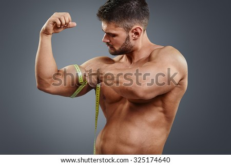 male measuring biceps stock photos images pictures shutterstock. Black Bedroom Furniture Sets. Home Design Ideas