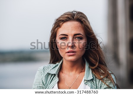 closeup head and shoulders portrait of yong adult beautiful woman - stock photo