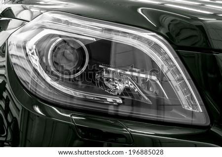 Closeup headlights of business car. Exterior detail. - stock photo