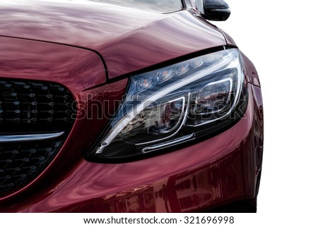 Closeup headlights of ca and Car exterior detail with White backCloseup headlights of car. Modern luxury car close-up banner background. Concept of expensive, sports auto Closeup headlights - stock photo