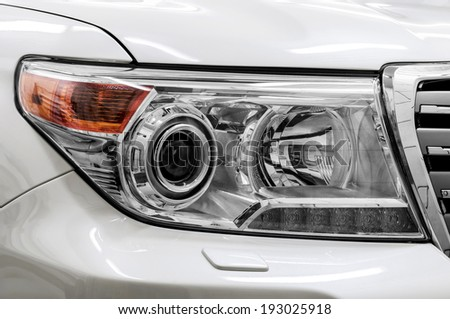 Closeup headlights of car. - stock photo