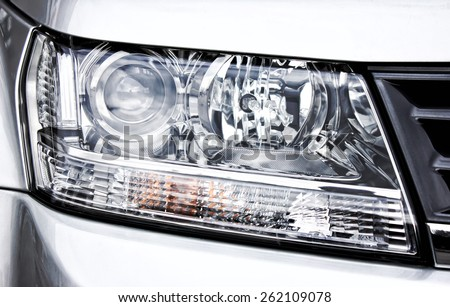 Closeup headlights of car. - stock photo