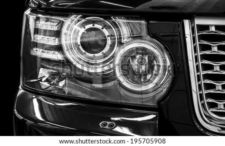 Closeup headlights of car. Car exterior detail. - stock photo