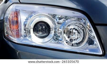 Closeup headlights of car.modern light element. - stock photo