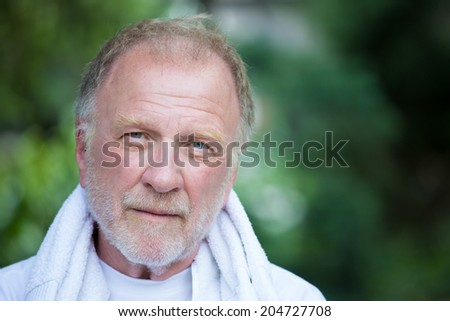 Closeup headshot portrait of happy, confident, cheerful, smiling senior mature man, isolated green trees foliage background. Positive human emotions, facial expressions, feelings, attitude - stock photo