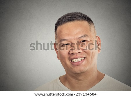 Closeup headshot portrait of middle aged man happy smiling, isolated on grey wall background. Positive face expression, emotion, feelings, life perception  - stock photo