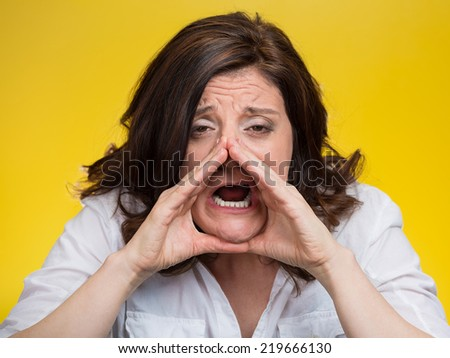 closeup headshot portrait of young angry woman screaming isolated on yellow background. Negative face expressions, emotions, feelings - stock photo