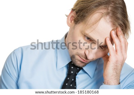 Closeup headshot portrait, sad bothered stressed serious young man, looking down, depressed about something, someone, isolated white background. Negative human emotion facial expression feeling