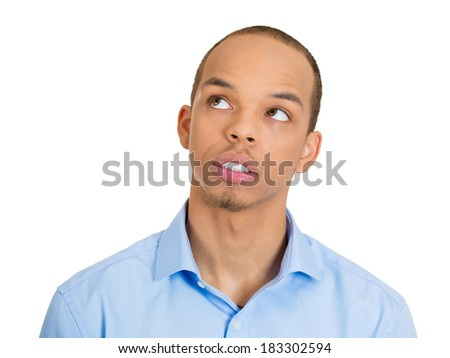 Closeup headshot portrait, serious young man thinking, daydreaming deeply, bothered by something, looking upwards, isolated white background. Negative human emotions, facial expression feeling - stock photo