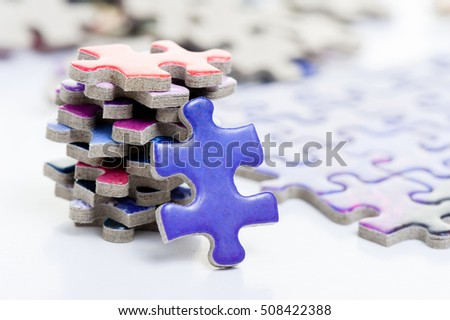 closeup heap of colorful jigsaw puzzle game