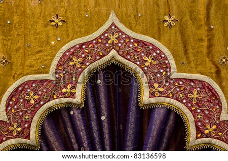 Closeup image detail of Indian fabric used in the decor of a wedding - stock photo