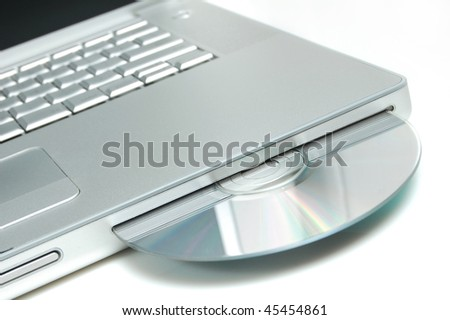 Closeup image from a laptop and a CDRom / DVDRom reader