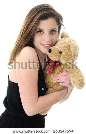 Closeup image of a beautiful teen brunette hugging a generic tan teddy bear.  On a white background. - stock photo