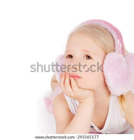 closeup image of a dreaming beautiful little girl