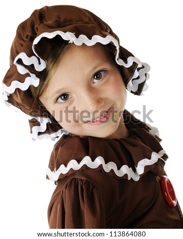 """Closeup image of a happy young """"gingerbread girl.""""  On a white background. - stock photo"""