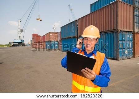 Closeup image of a longshoreman at work  - stock photo
