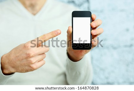 Closeup image of a male hand pointing at smartphone display - stock photo