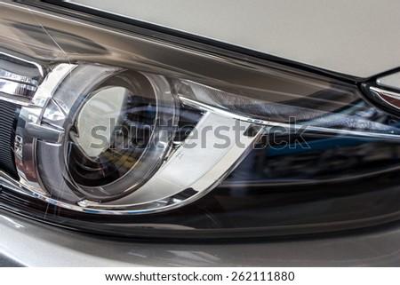 closeup image of a modern car head lamp - stock photo