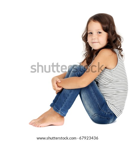 closeup image of a pretty little girl sitting on the floor in jeans - stock photo
