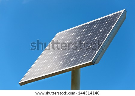 Closeup image of an electrical solar panel with blue sky.