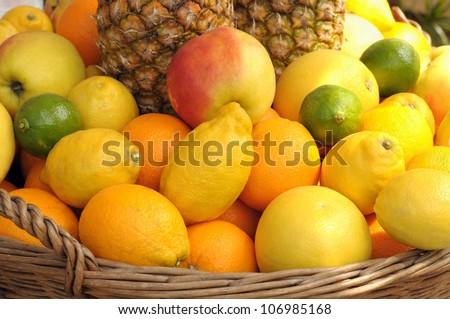 Closeup image of basket with fruits - stock photo