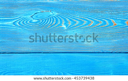 Closeup image of bumpy wooden wall background painted blue paint - stock photo
