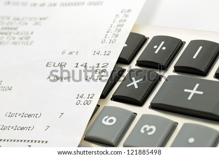 Closeup image of calculator keyboard and a receit from shop - stock photo