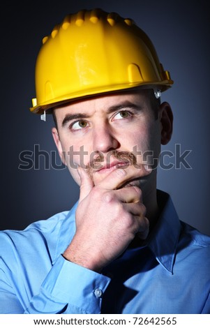 closeup image of caucasian thinking engineer portrait