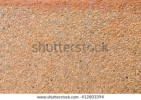 Closeup image of Cement with small gravel texture