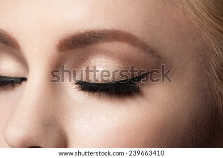 Closeup image of closed woman eyes with beautiful bright makeup.