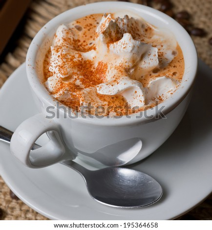 Closeup image of coffee with whipped cream  - stock photo