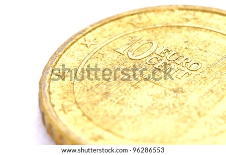 closeup image of 10 Euro cent coin on white background