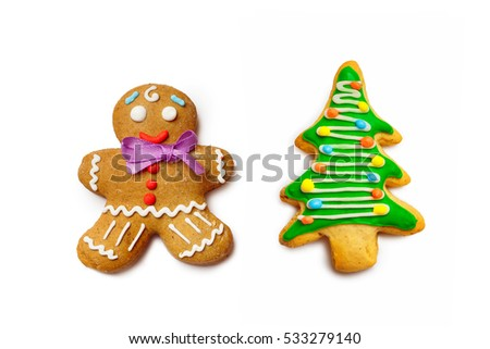 Closeup image of gingerbread man and christmas tree isolated at white background.